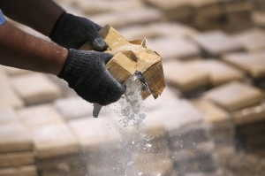 A policeman prepares seized drugs to be burned outside of Chinandega city