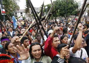 Ecuadorean Ashuar Indians shout in front of Carondelet Palace during a march to protest against President Correa's policies, in Quito